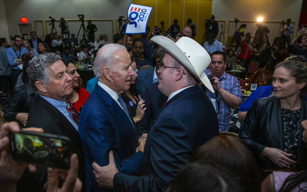 Former Vice President Joe Biden, left, speaks with Andrew Pritt of Warren, Ark., during the Cla ...