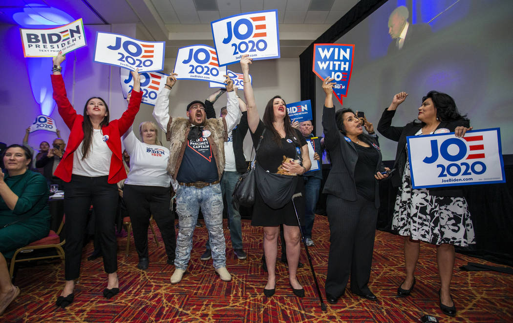 Former Vice President Joe Biden supporters cheer as he speaks during the Clark County Democrats ...