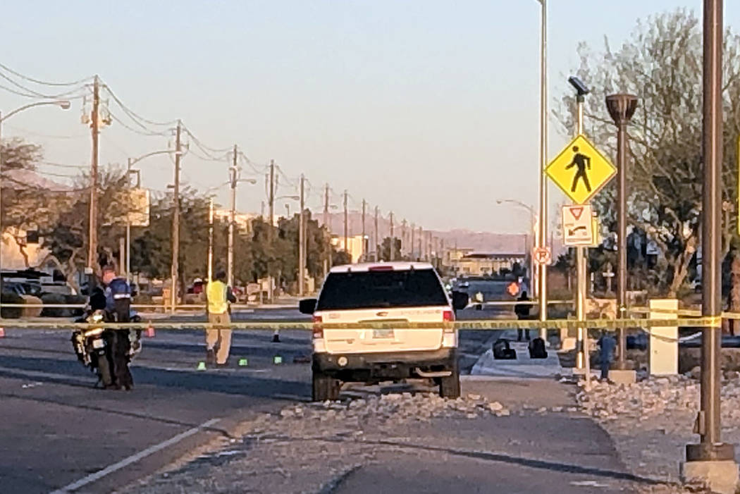 North Las Vegas police investigate after a crash at Lone Mountain and Losee roads in North Las ...