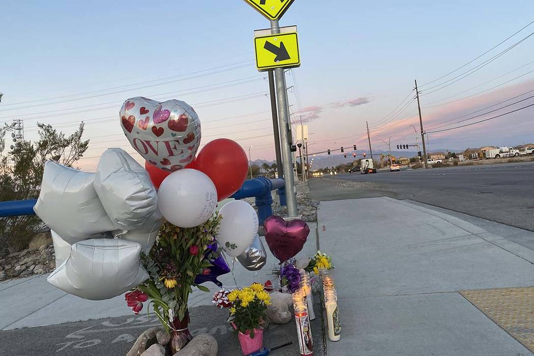 A memorial for a brother and sister hit by a truck on Friday, Feb. 14, 2020, sits next to a cro ...