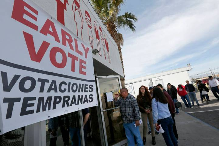 People line up to vote on the first day of early voting in the Nevada Democratic Party's presid ...