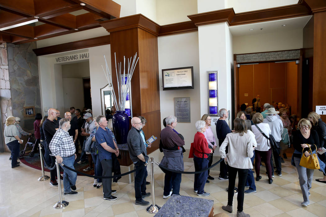 People line up for early voting in the Nevada Democratic caucuses at the Anthem Center in the S ...