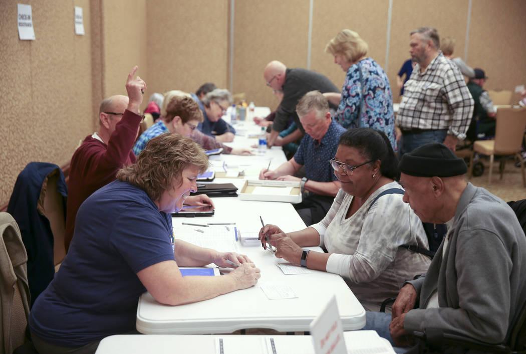 Volunteer Nancy Adams of Henderson, helps Phyllis Shurn-Hannah, 68, and her husband Edwin Hanna ...