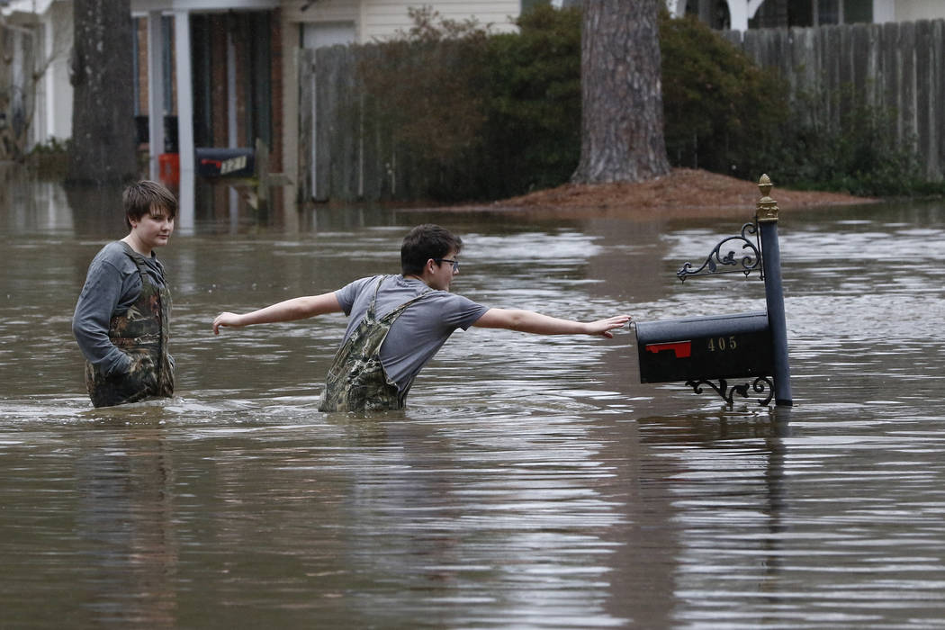Blaine Henderson, right, reaches to tag a mailbox as Pearl River as he and his friend Jonah Val ...