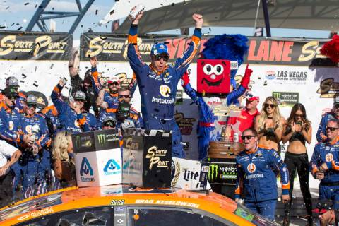 Race car driver Brad Keselowski celebrates in victory lane after winning the South Point 400 NA ...