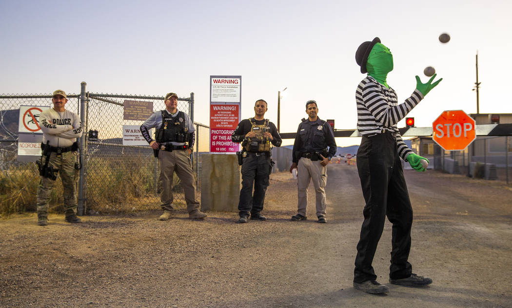 Scott Samford of Hollywood as an alien juggling mime entertains the security personnel at the b ...