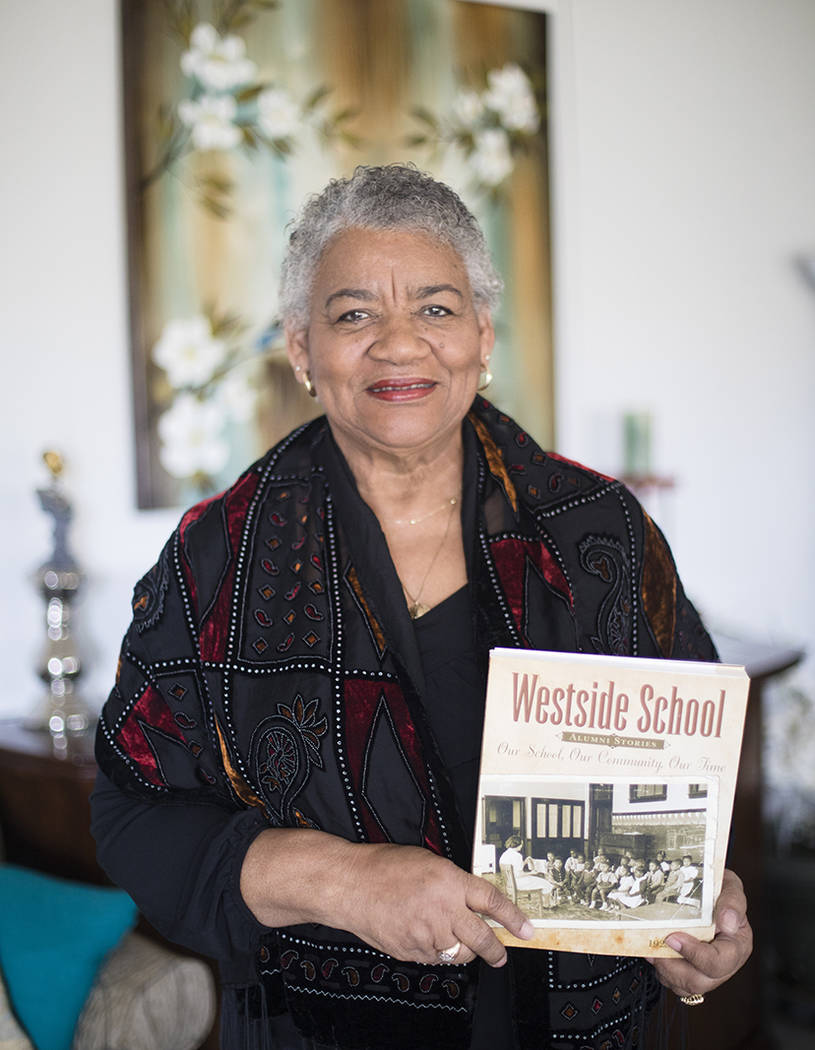 """Brenda J. Williams, author of """"Westside School: Our School Our Time,"""" holds the book at her hom ..."""