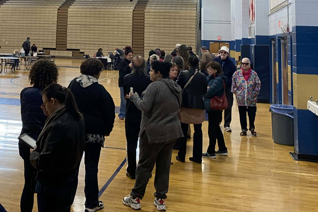 Voters participating in early voting for the Democratic caucus faced long lines at Cheyenne Hig ...