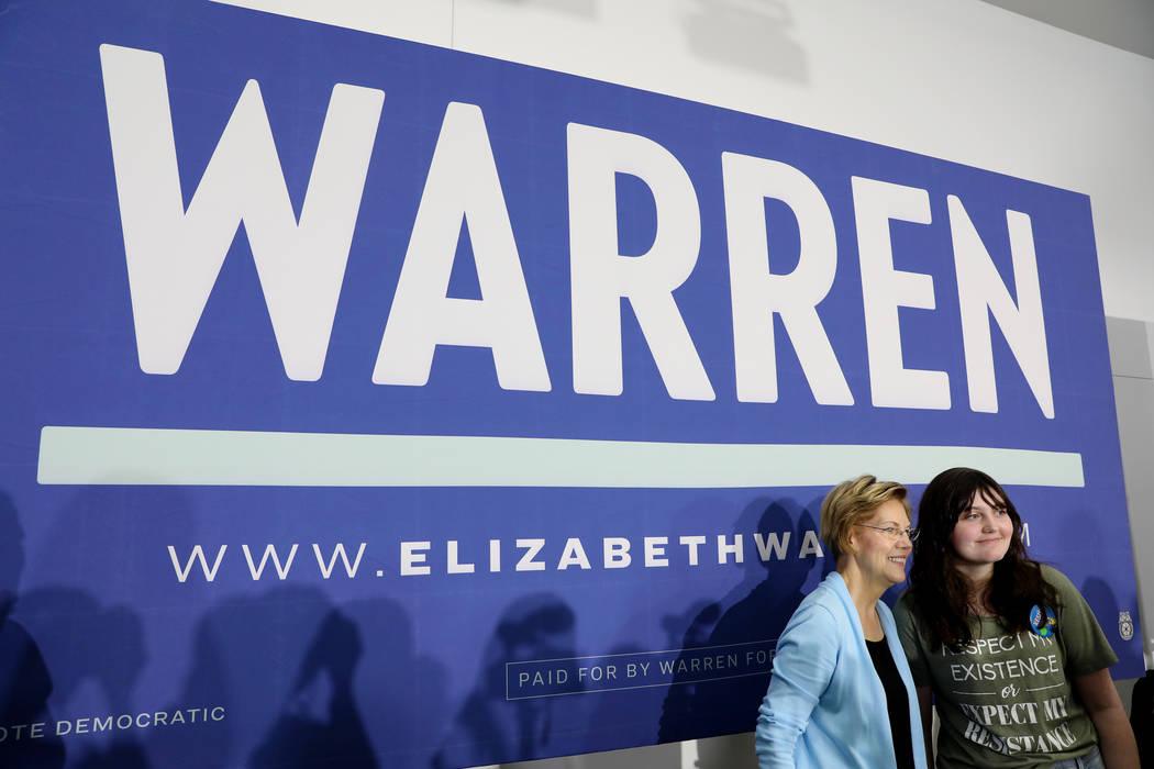 Sen. Elizabeth Warren takes a photograph with Audrey Hanna, 13, of Henderson, after Warren spok ...