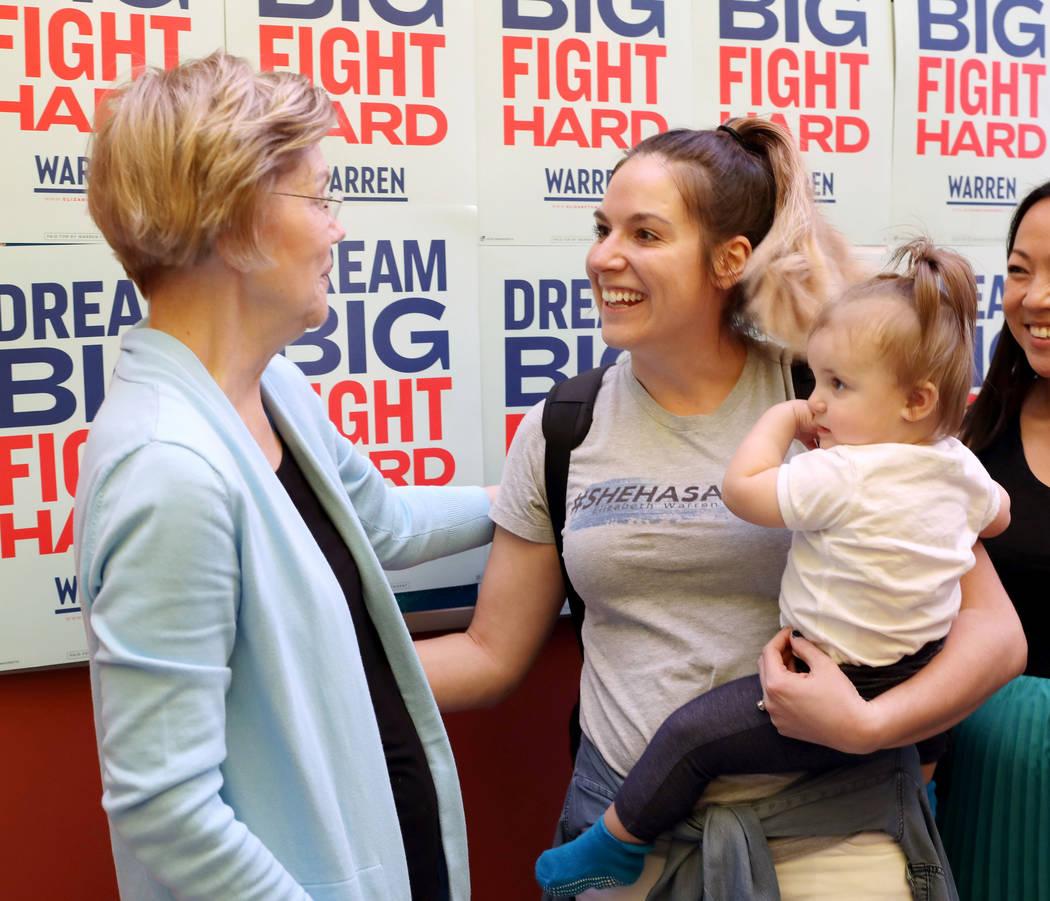 Sen. Elizabeth Warren meets supporter Brett Hagerty and her daughter Margot, 1, at College of S ...