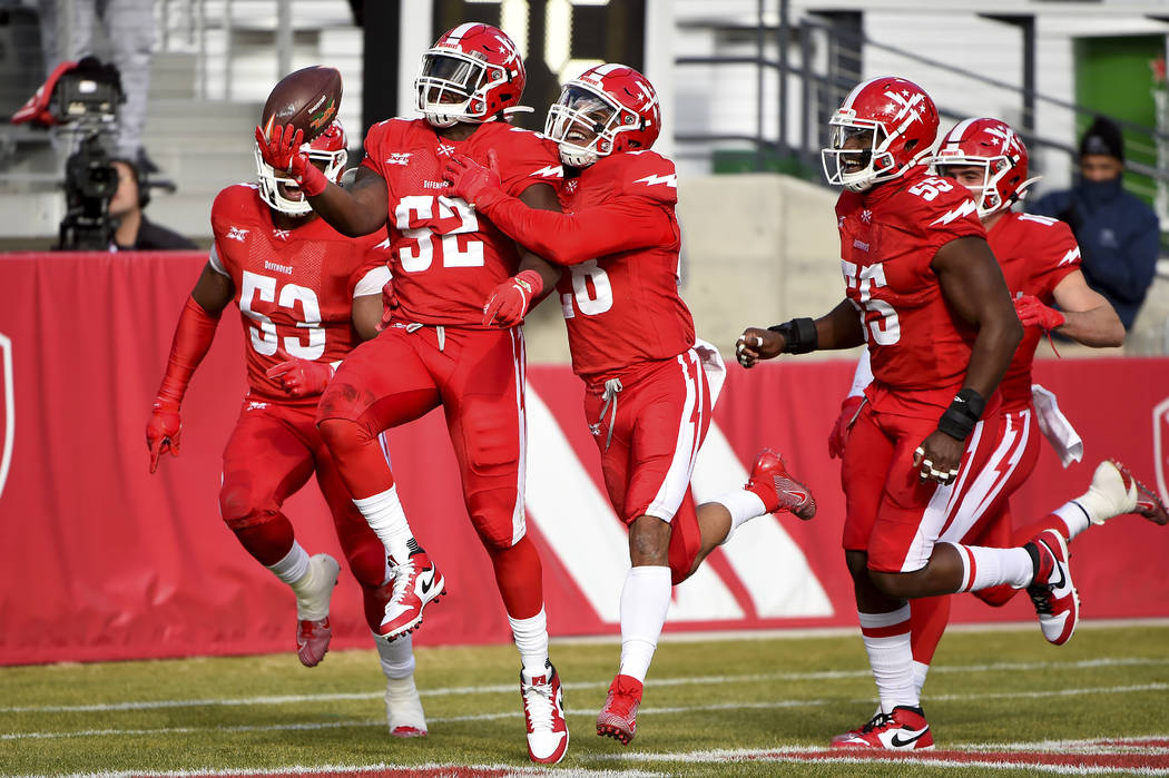 DC Defenders linebacker Jonathan Celestin (52) celebrates with teammates after scoring a touchd ...