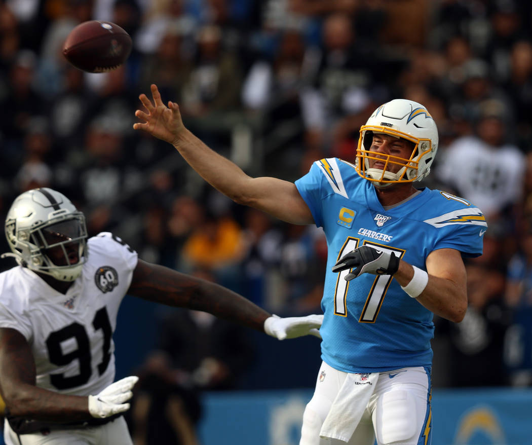 Los Angeles Chargers quarterback Philip Rivers (17) throws the football as Oakland Raiders defe ...