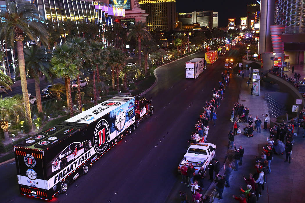The hauler of Kevin Harvick (4) parades down the Las Vegas Strip near Harmon Road ahead of the ...