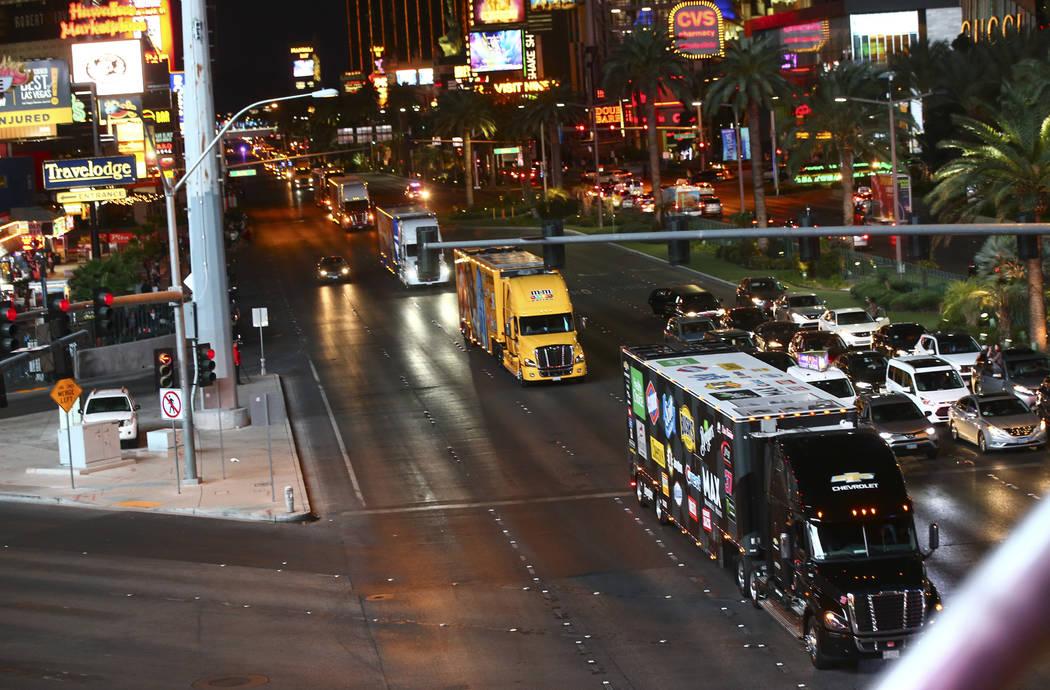 The haulers of Chris Buescher (37) and Kyle Busch (18) parade down the Las Vegas Strip near Har ...