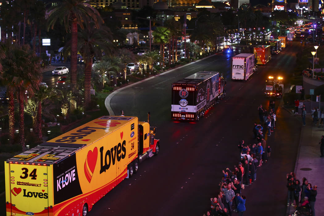 The haulers of Michael McDowell (34) and Kevin Harvick (4) parade down the Las Vegas Strip near ...