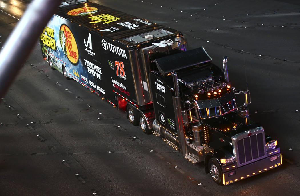 The hauler of Martin Truex Jr. (78) parades down the Las Vegas Strip near Harmon Road ahead of ...