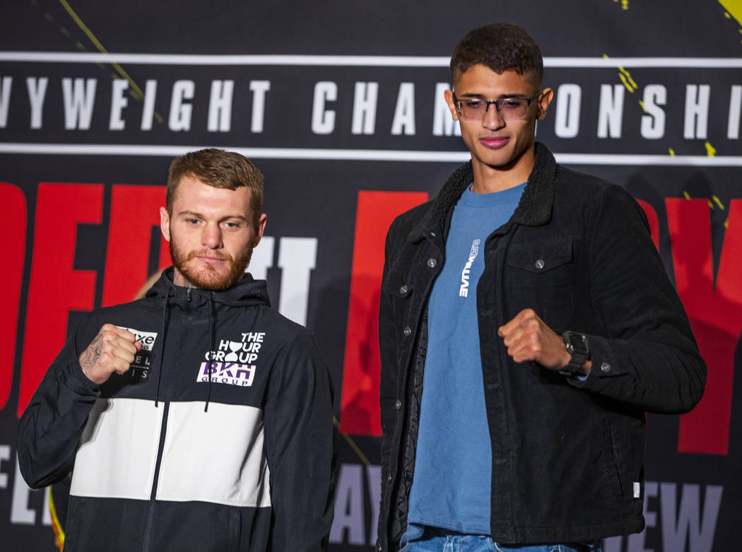 Junior middleweight's Daniel Lewis, left, and Sebastian Fundora on the stage during the Grand A ...