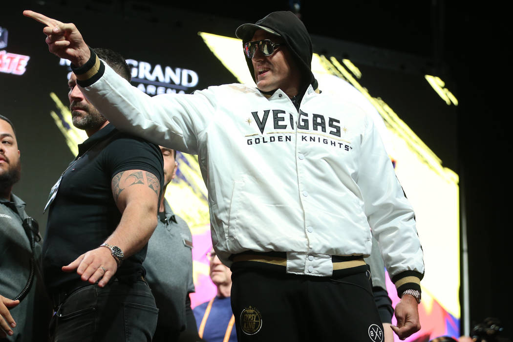 Tyson Fury gestures at Deontay Wilder, not pictured, during a press conference at the MGM Grand ...