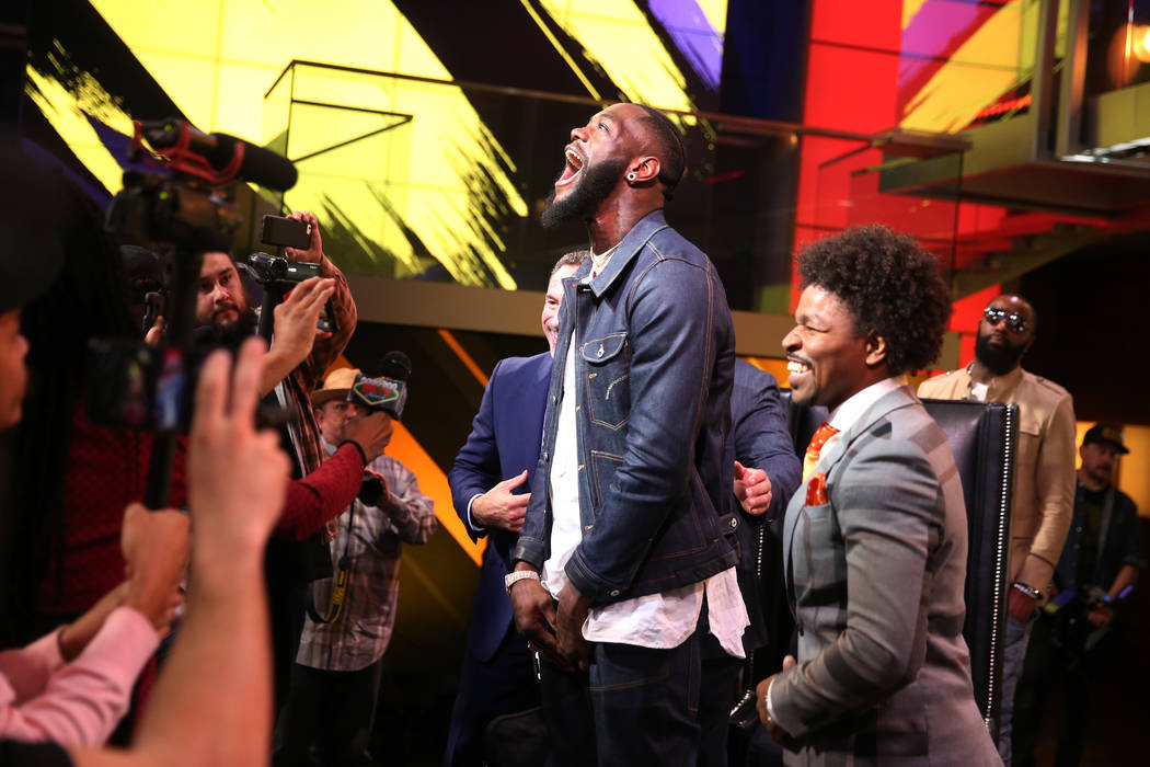 """Deontay """"The Bronze Bomber"""" Wilder, center, during a press conference at the Fox Studios in Los ..."""