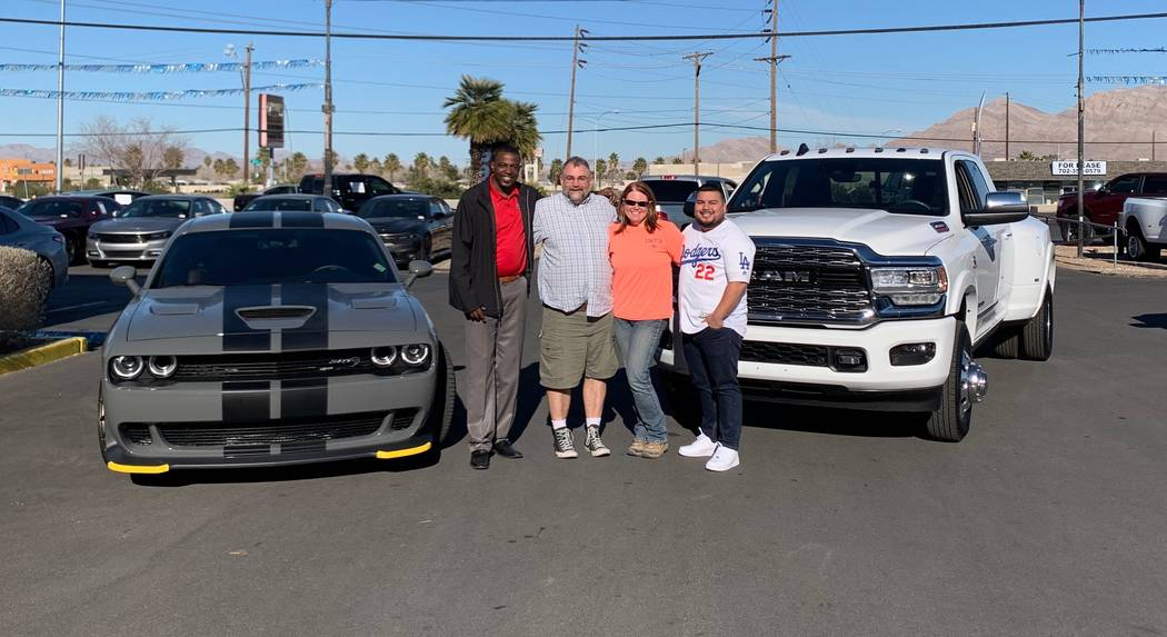 Sales Manager Jesse Aguirre, from left, Mitch Moore, Kristen Moore and Finance Manager Sanchez ...