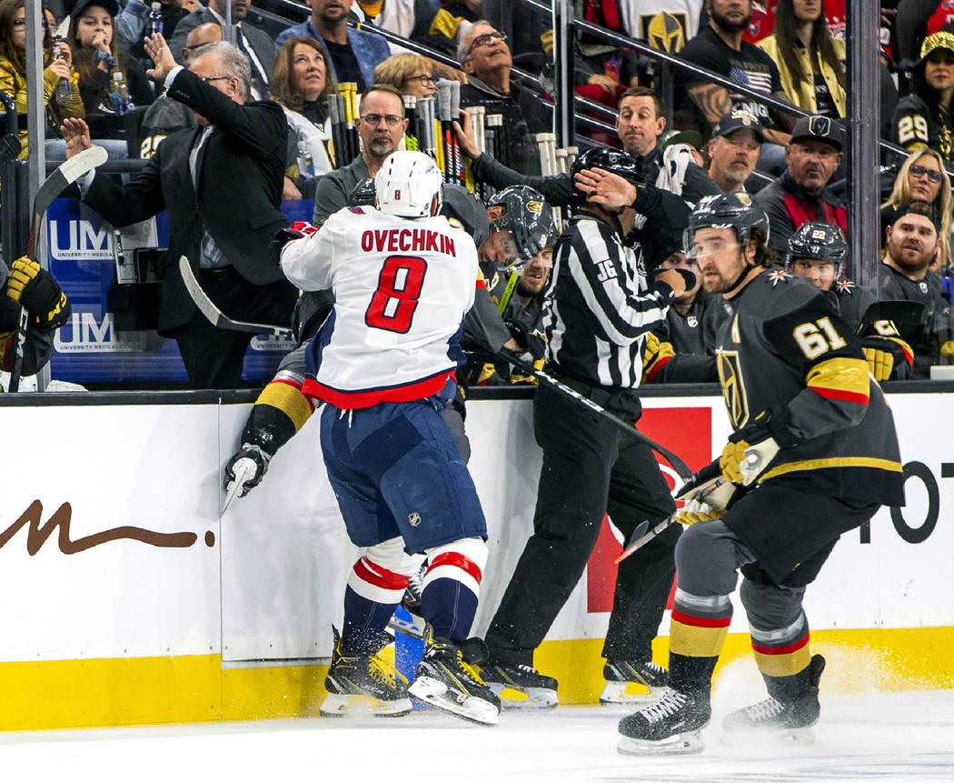 Washington Capitals left wing Alex Ovechkin (8) blasts Vegas Golden Knights center William Kar ...