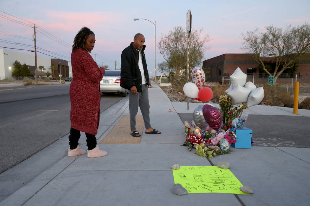 Michelle Johnson and Roy Simms of North Las Vegas pays her respects Monday, Feb. 17, 2020, at a ...