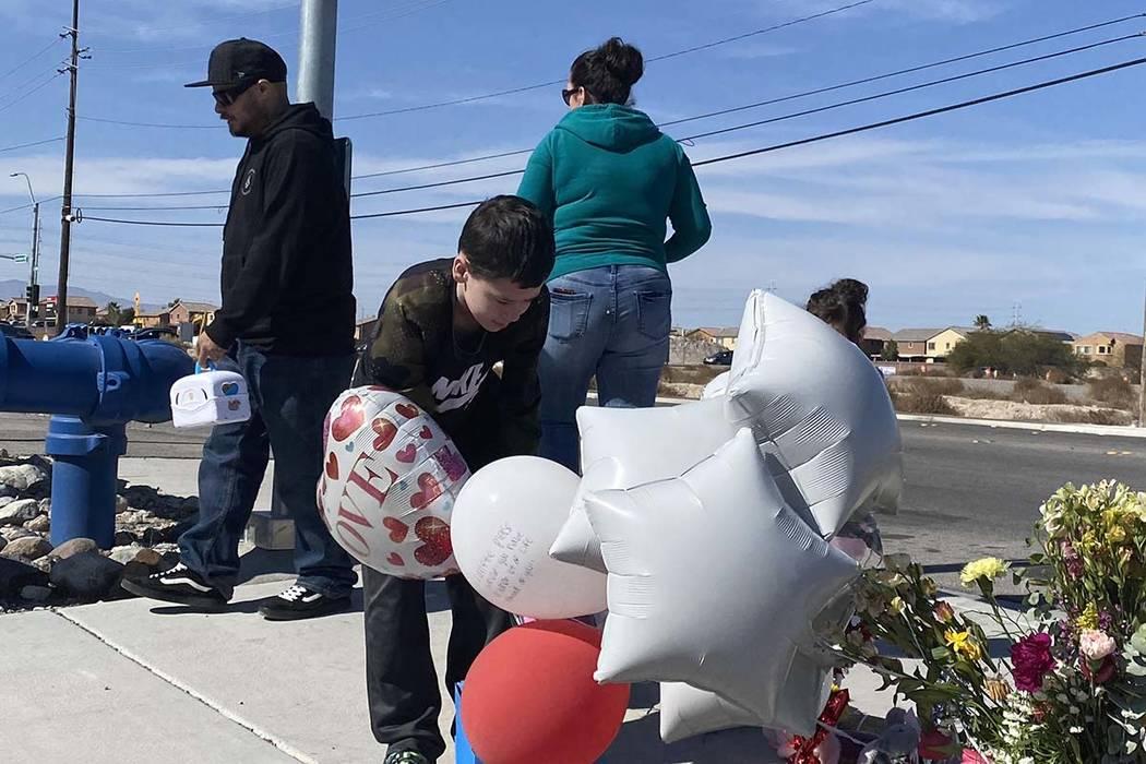 Aiden Maffett, 10, drops off a hockey and super hero box in memory of Alex Bush, 12, at a memor ...