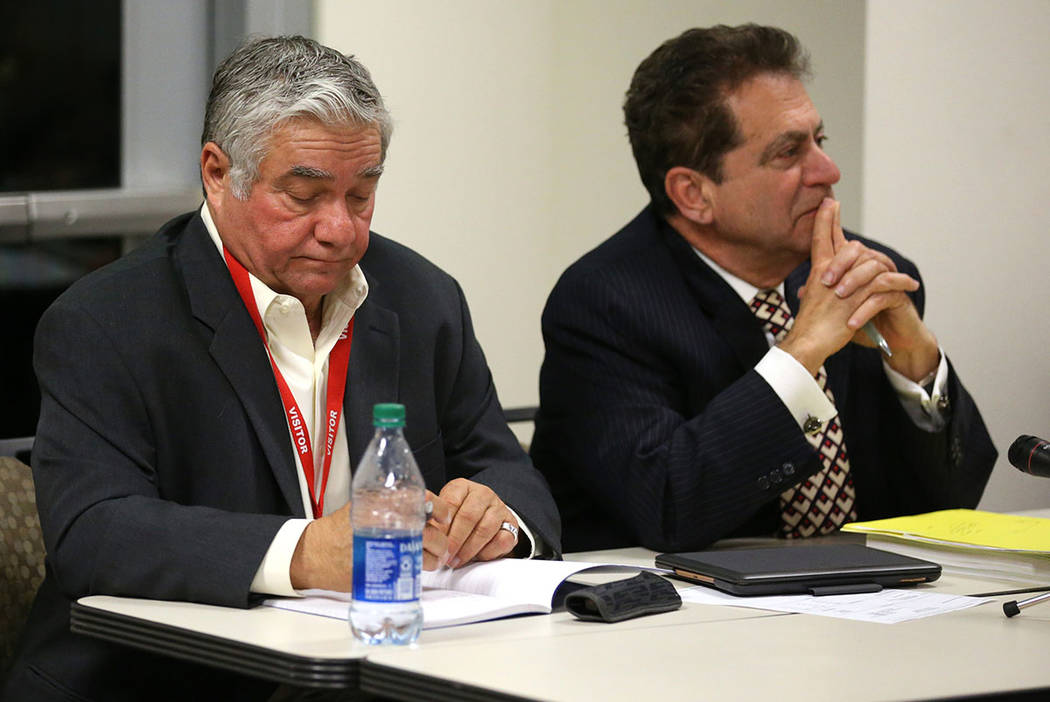 Former Henderson Constable Earl Mitchell, left, and his attorney Marc Risman reacts to the Stat ...