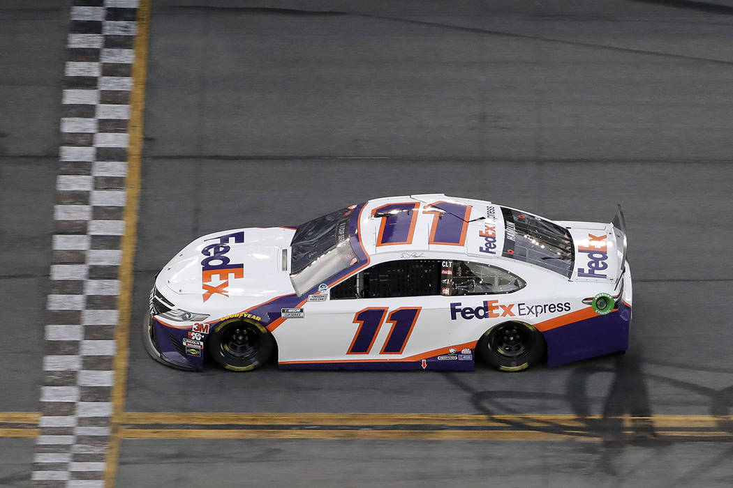 Denny Hamlin (11) gets to the line to win the second stage during the NASCAR Daytona 500 auto r ...