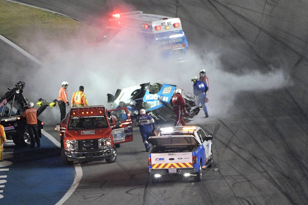 Track personnel arrive to help Ryan Newman (6) after he flipped his car on the final lap in fro ...