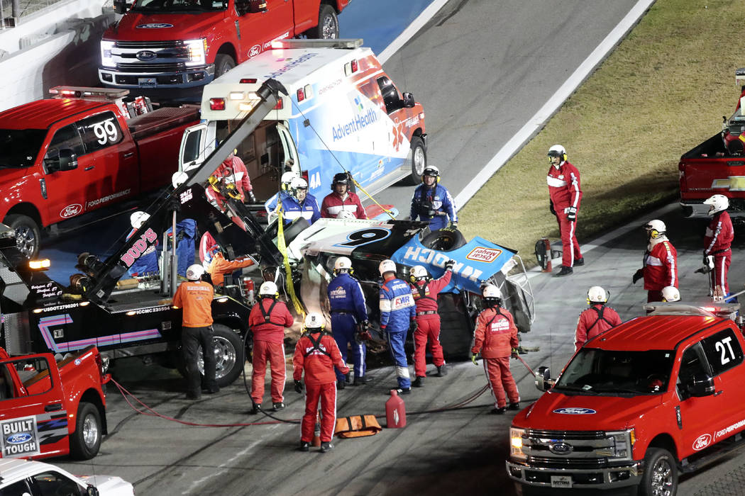 Rescue aid Ryan Newman after he was involved in a wreck on the last lap of the NASCAR Daytona 5 ...