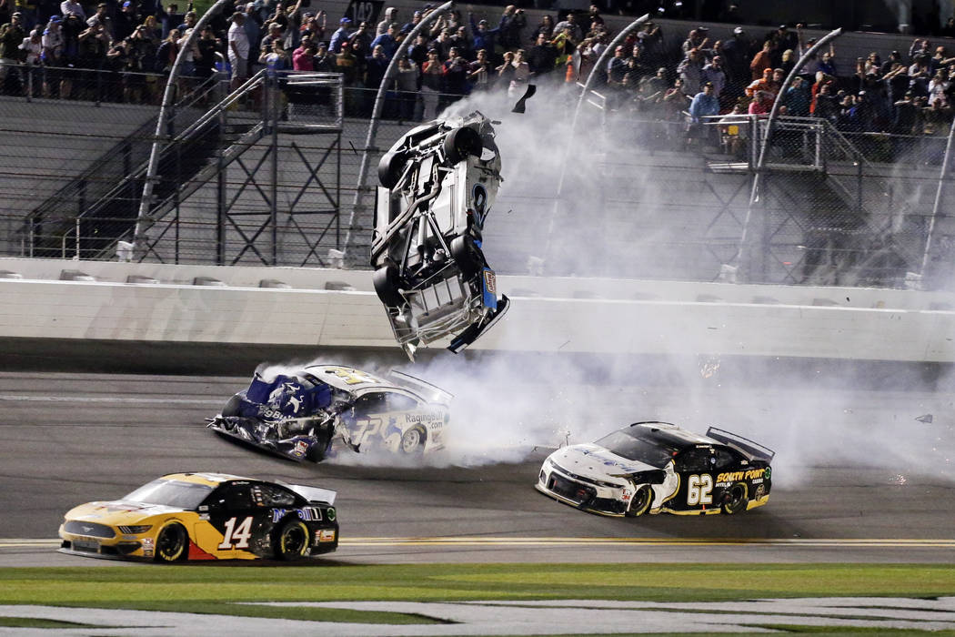 Ryan Newman, top center, goes airborne as he is hit by Corey LaJoie (32) on the final lap of th ...
