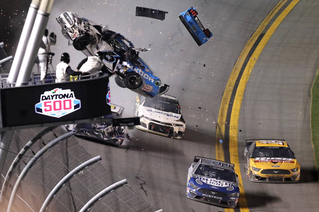 Ryan Newman (6) crashes on the last lap of the NASCAR Daytona 500 auto race at Daytona Internat ...