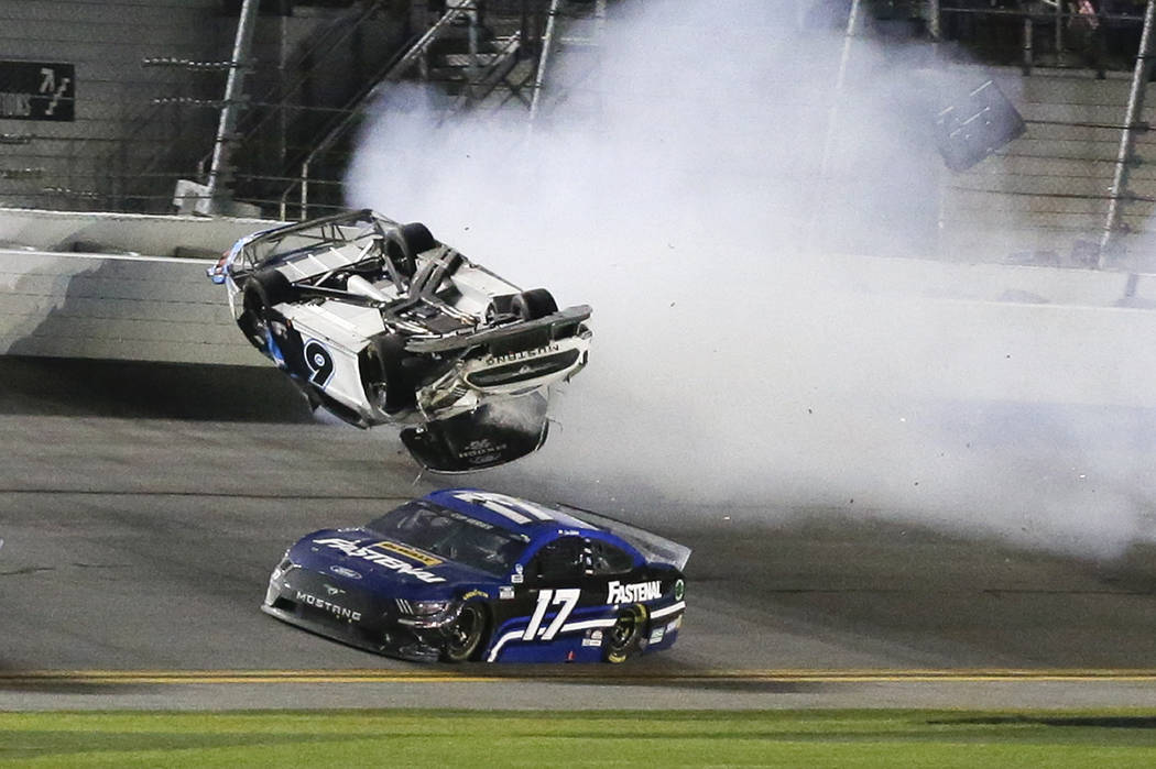Chris Buescher (17) goes low to avoid Ryan Newman (6) a he wrecks and flips on the final lap of ...