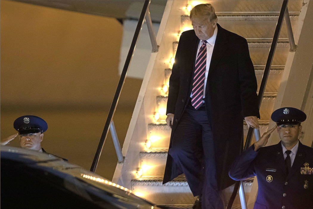 President Donald Trump arrives on Air Force One to McCarran International Airport on Tuesday, F ...