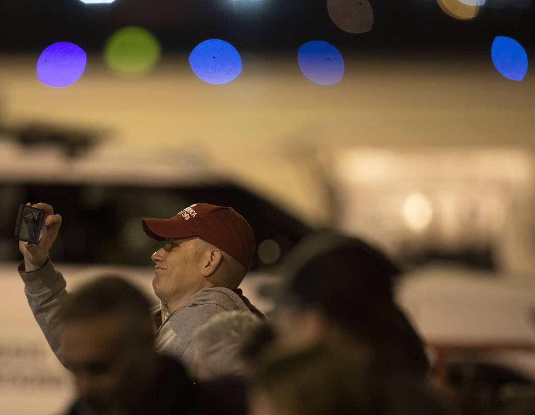 A Trump supporter photographs himself in front of Air Force One after President Donald Trump ar ...