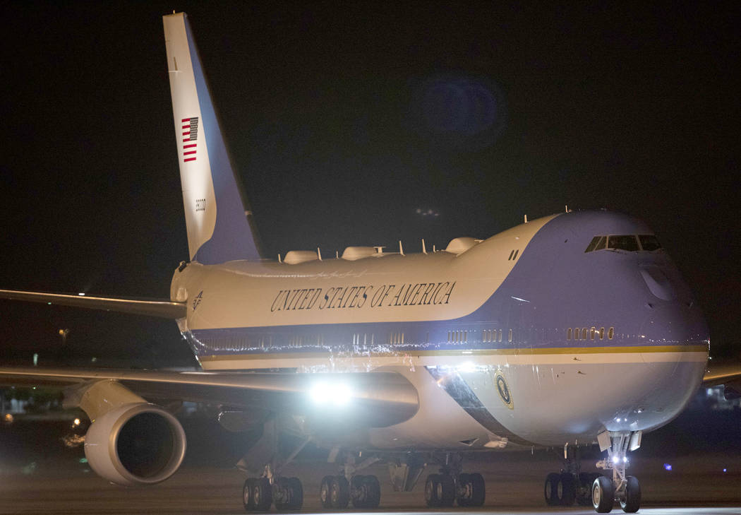 Air Force One arrives to McCarran International Airport on Tuesday, Feb. 18, 2020, in Las Vegas ...