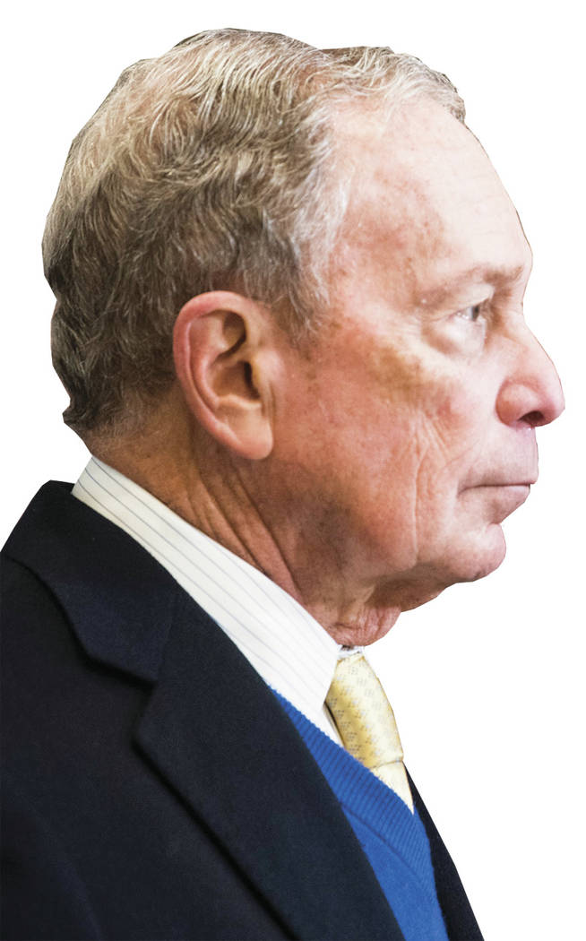 Democratic presidential candidate Mike Bloomberg talks with Alabama Democratic Conference chair ...
