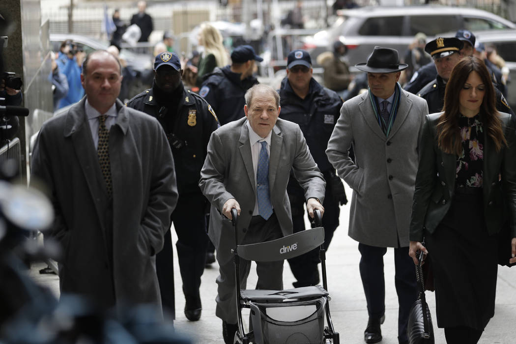 Harvey Weinstein, center, arrives at a Manhattan courthouse for his rape trial in New York, Tue ...