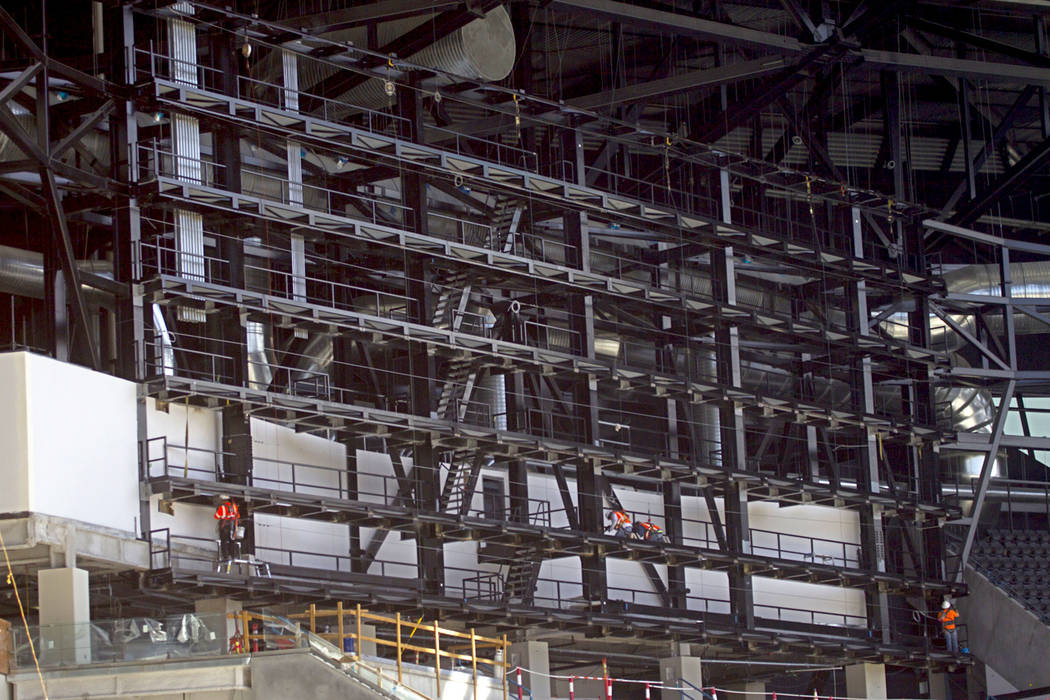 Crews install the support system for screens inside the Raiders Allegiant Stadium in Las Vegas, ...