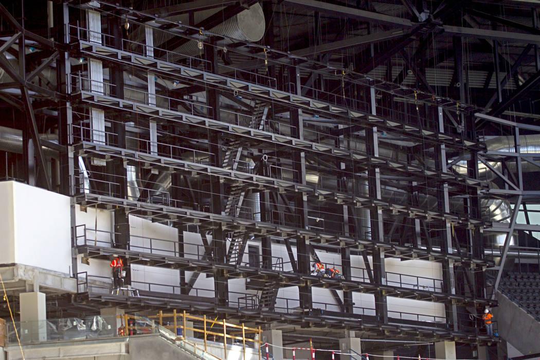Crews install the support system for screens inside the Raiders Allegiant Stadium in Las Vegas, ...