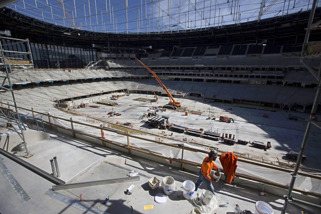 Construction crews on the field level of the the Raiders Allegiant Stadium in Las Vegas, Tuesda ...