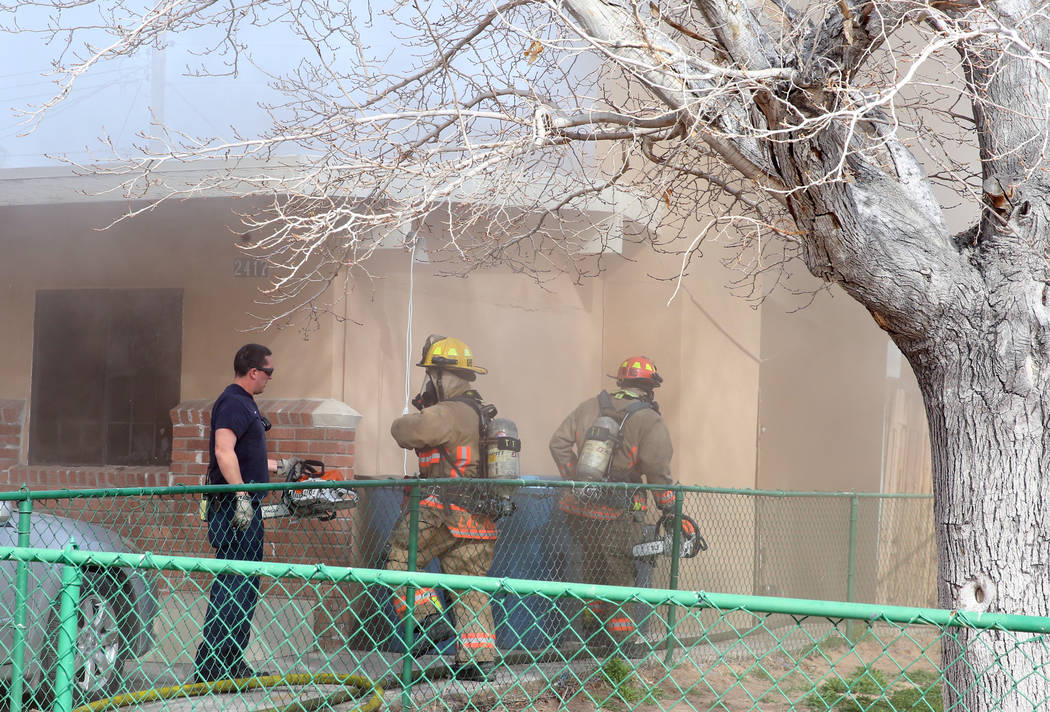 Las Vegas firefighters battle a house fire at 2417 Howard Drive on Tuesday, Feb. 18, 2020, in L ...