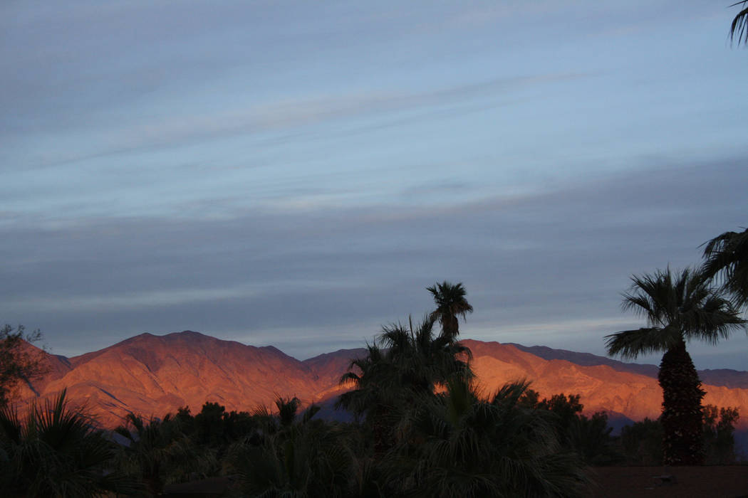 Sunset at Furnace Creek Ranch at Death Valley National Park, Calif., leaves the hillsides awash ...