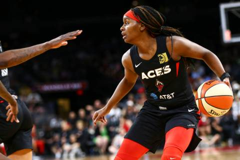 Las Vegas Aces guard Sugar Rodgers moves the ball against the Seattle Storm during the second h ...