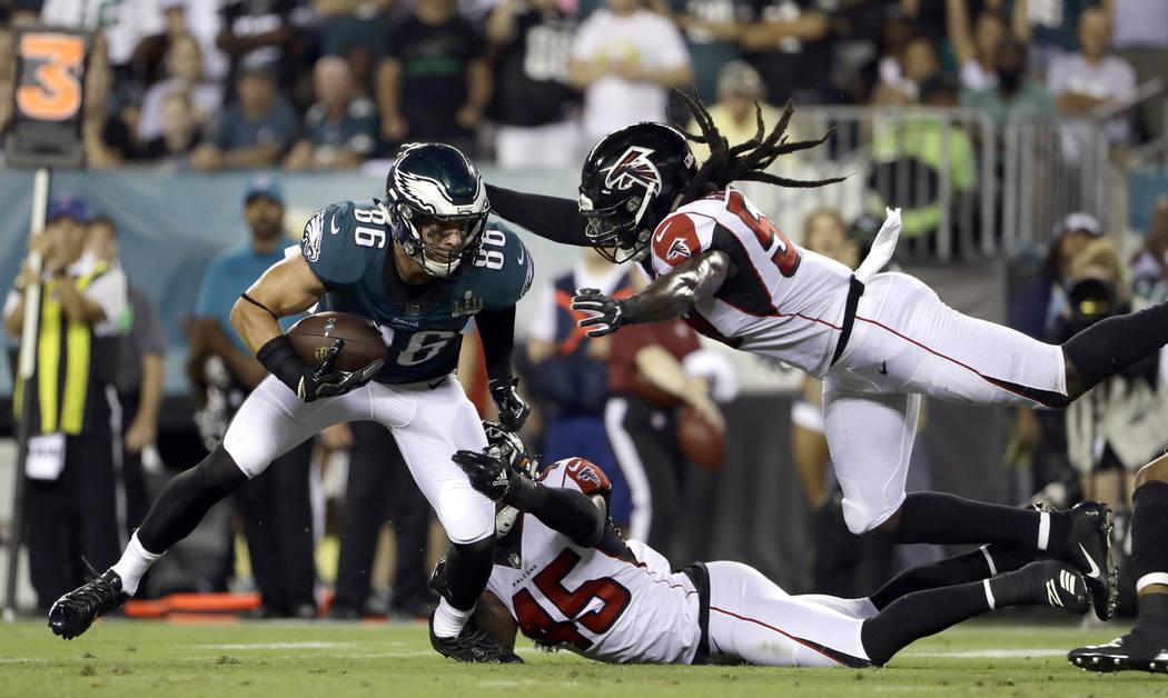 Philadelphia Eagles' Zach Ertz (86) tries to escape from Atlanta Falcons' Deion Jones (45) and ...