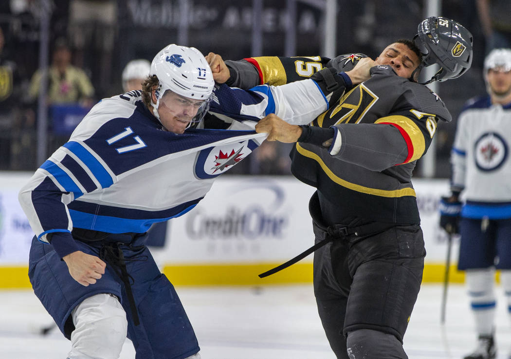Winnipeg Jets left wing Adam Lowry (17) and Vegas Golden Knights right wing Ryan Reaves (75) sc ...