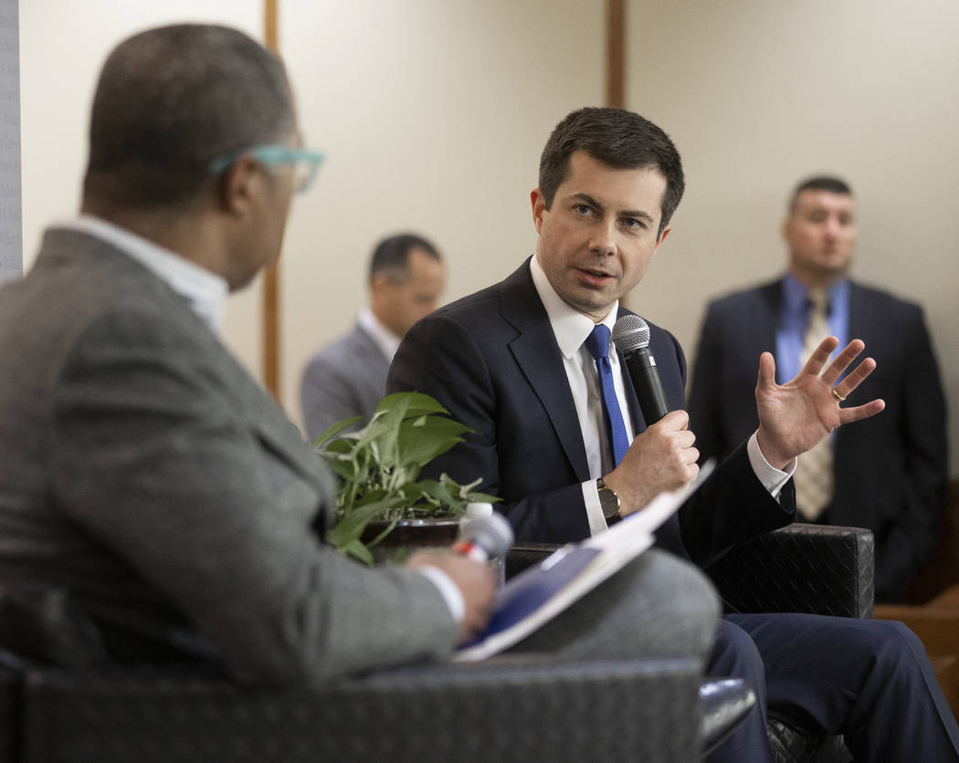 Democratic presidential candidate former South Bend Mayor Pete Buttigieg, right, speaks during ...
