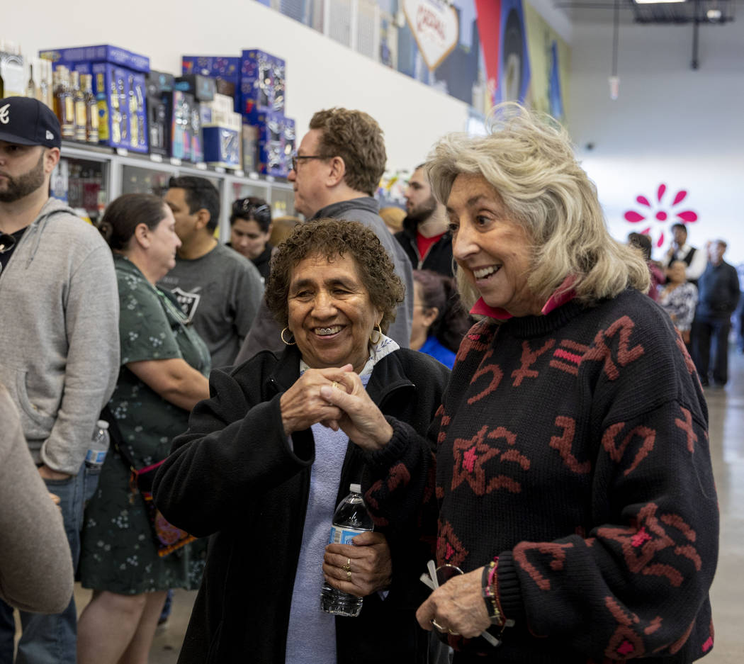 Guadalupe Cantu, 83, of Las Vegas, left, speaks with Rep. Dina Titus, D-Nev., as they wait in ...