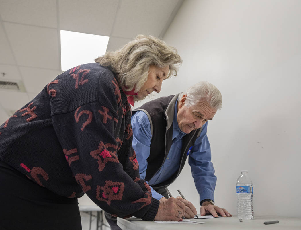 Rep. Dina Titus, D-Nev., left, and husband Thomas Wright cast their early vote at Cardenas Mark ...
